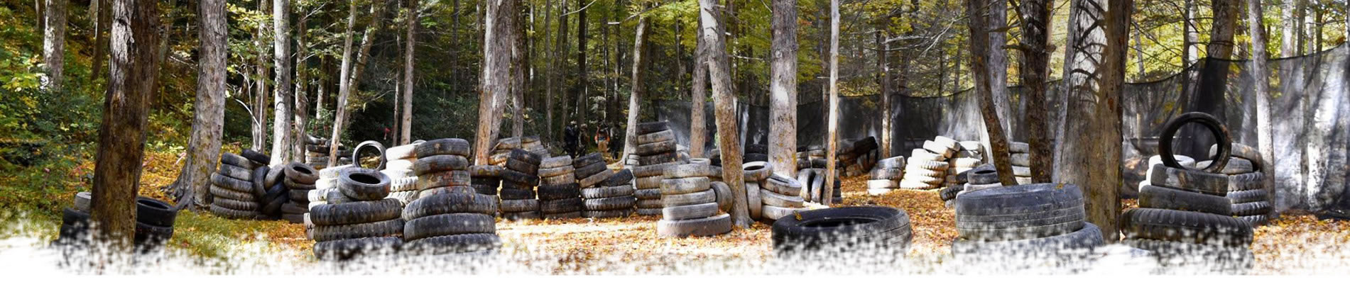 photo of an airsoft field with tires
