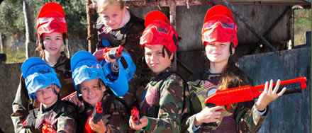 kids playing paintball with red and blue gotcha markers