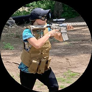 photo of a woman holding an airsoft gun
